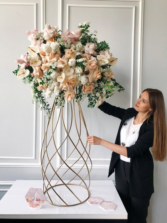 We want to give more interpretations of stands for floral arrangement . And Handcrafted new metal stand made by spiral technology. Luxury wedding decoration must have such a beautiful stands on tables. Our stands are hard so you can easily put any weight on them. NOTE!!!: BY THIS PURCHASE YOU GET