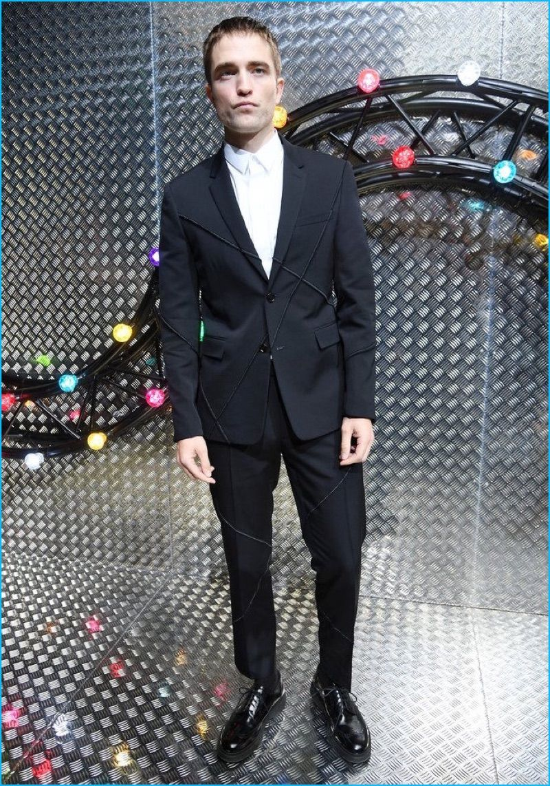 0526ffcc8688 June 2016  Robert Pattinson poses for pictures at Dior Homme s spring-summer  2017 show during Paris Fashion Week. Pattinson dons a sharp