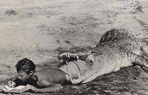 Peter Beard in the mouth of a crocodile