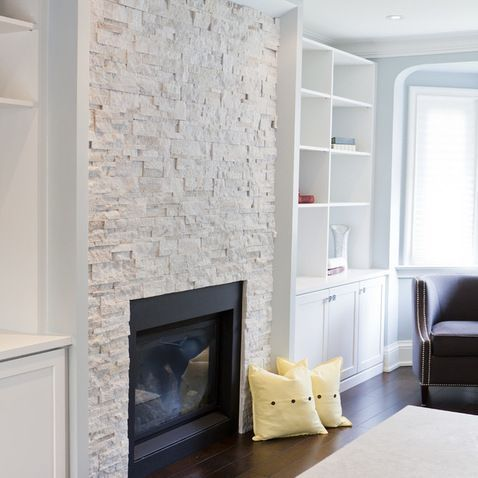 Grey Stone Tile Pattern . A Massive Fireplace Made Out Of Metal Is In Form  Of