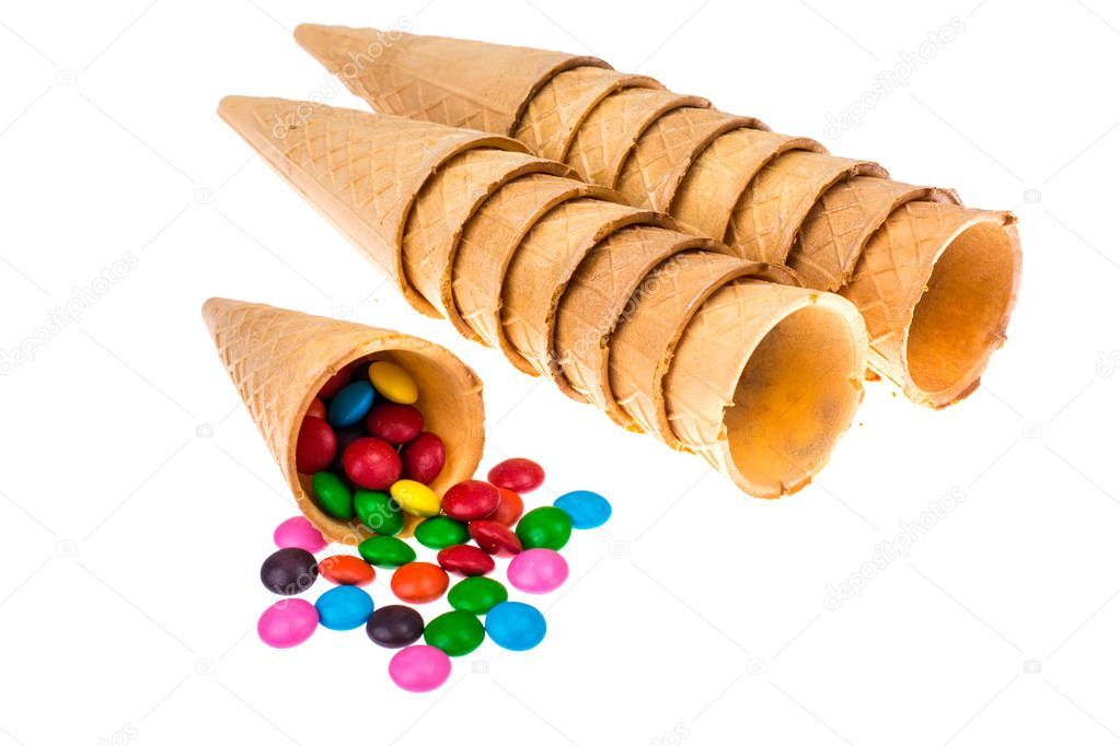 Crispy waffle cones with colorful candies stock photo