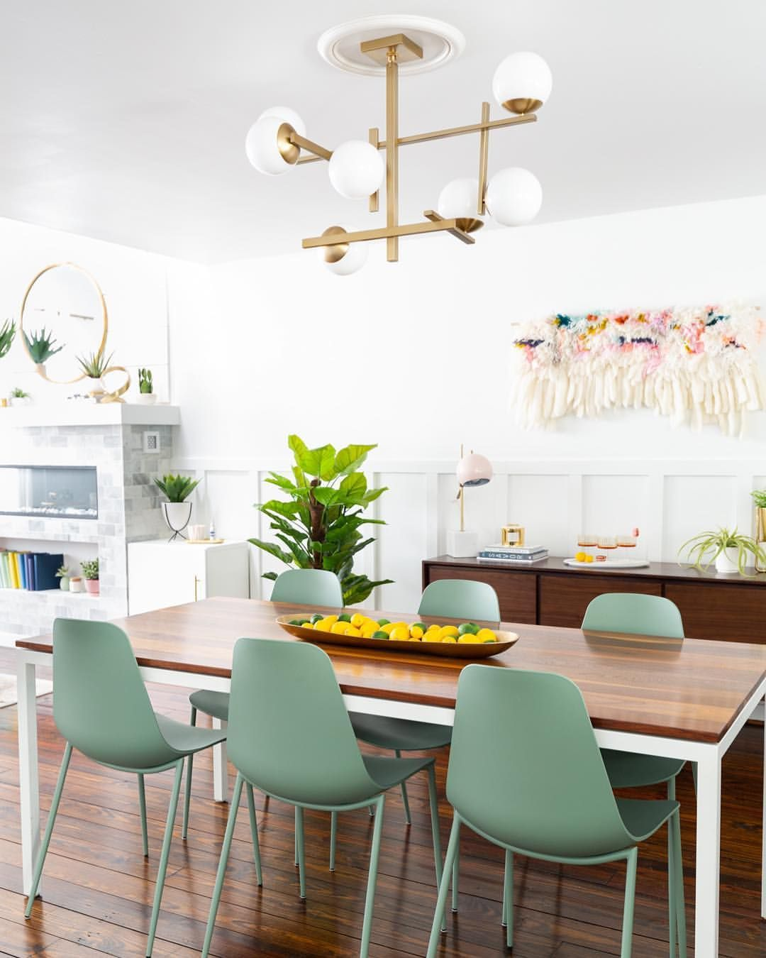 Modern Dining Room With Wood Furniture And Muted Mint Green Chairs