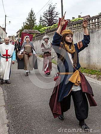 Nogent le Rotrou, France- May 19th, 2012: Parade of medieval characters with a traditional costumes marching near the Saint Jean Castle in Nogent le Rotrou,France, during a a historical reenactment festival.