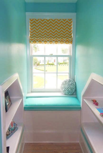 Roman Shades in Chevron Print with blackout lining top the dormer windows in an attic retreat.