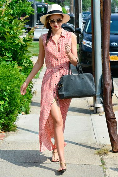 Hats Off: The Best Celebrity Toppers - Miranda Kerr adds a touch of city chic to her breezy Creatures of Comfort maxi with oversize Miu Miu shades and an ultra-cool Panama hat.