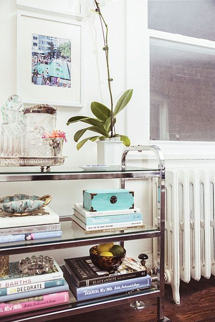 Turn One Into A Bookshelf With Coffee Table Books And Objets D Art 25 Awesomely Creative Ways To Use Bar Cart