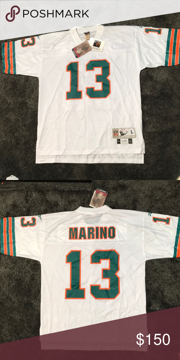 ca0b03ea984 Reebok throwback Dan Marino Miami Dolphins jersey Reebok Miami Dolphins  throwback Dan Marino #13 jersey in white. Jersey is brand new with tags.
