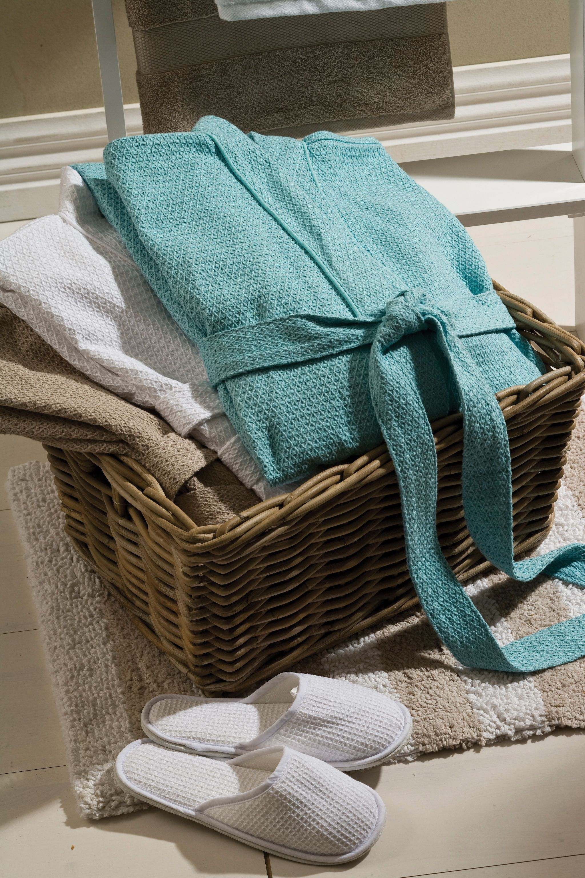 Coordinate the Bliss waffle robe and slippers to evoke a hotel vibe ...