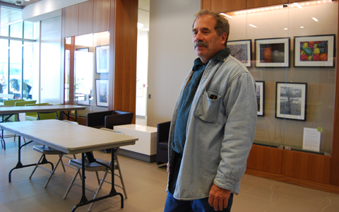 John Oughton at Fireside Gallery at Progress Campus Library of Centennial College. Besides being a photographer, Oughton is also a professor at the college, a poet and the author of five books.