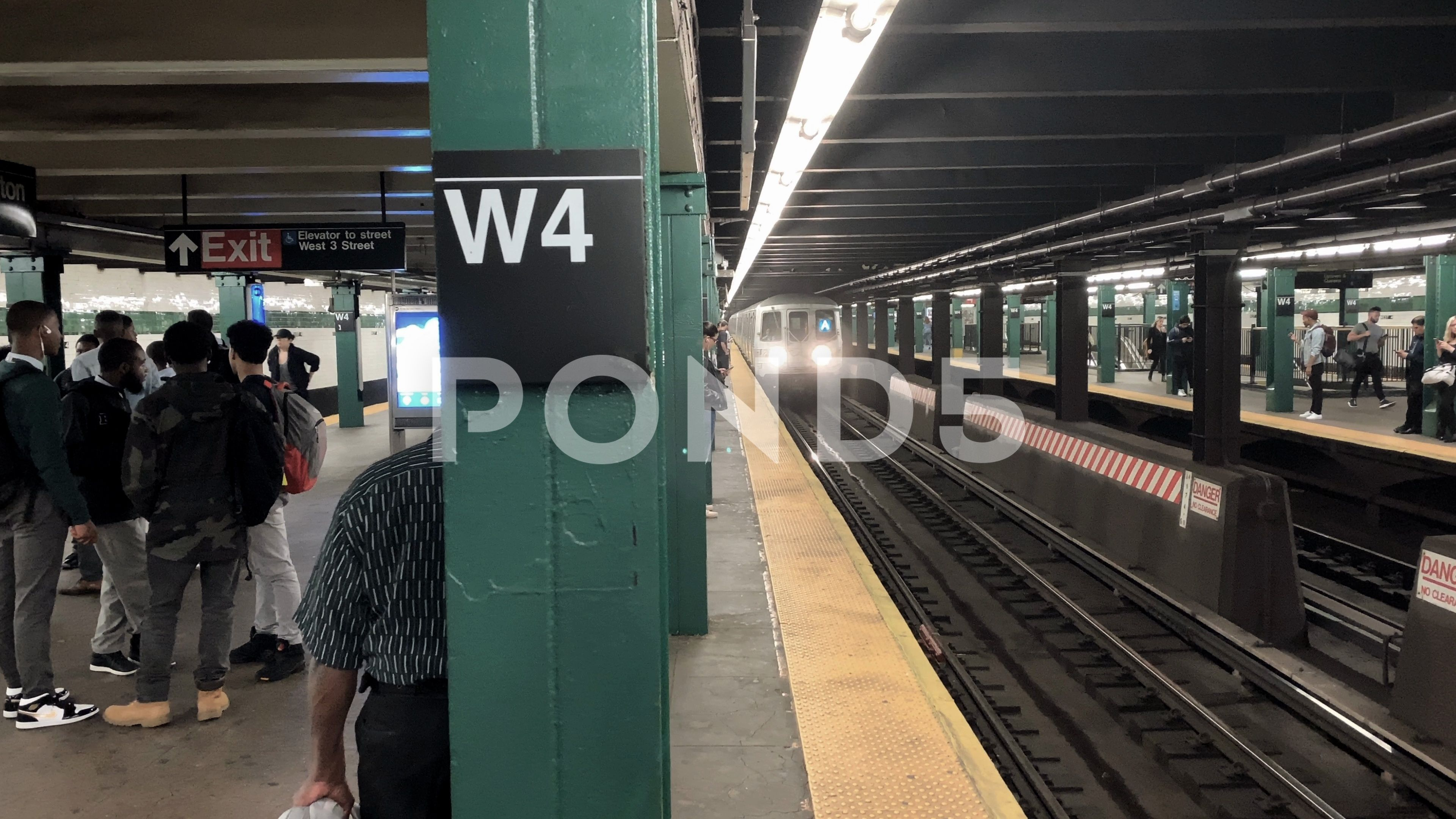 A Train Entering Subway Station Platform Head On West 4th