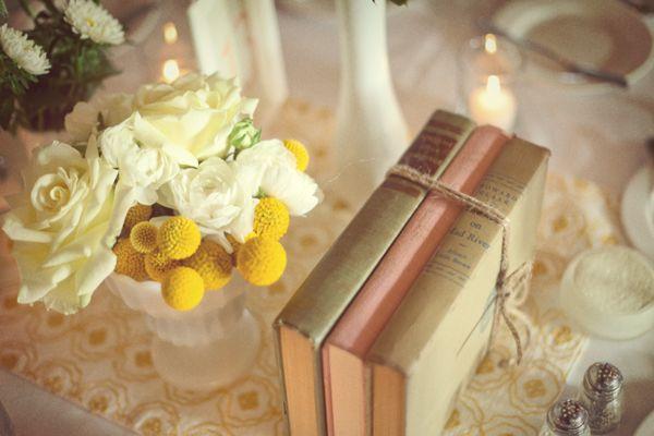 vintage hardback books and milk glass vases for centerpieces