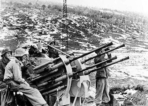 Monte Camino (Just south of the Gustav Line) November - December 1943: A German anti-aircraft gun crew keep watch in the snow covered hills near Monte Camino, Italy.