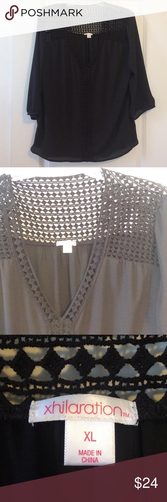 NWOT black v-neck blouse from Target NWOT black v-neck blouse from Target. Just did not fit me. Woven detail on the front and back! Xhilaration Tops Blouses