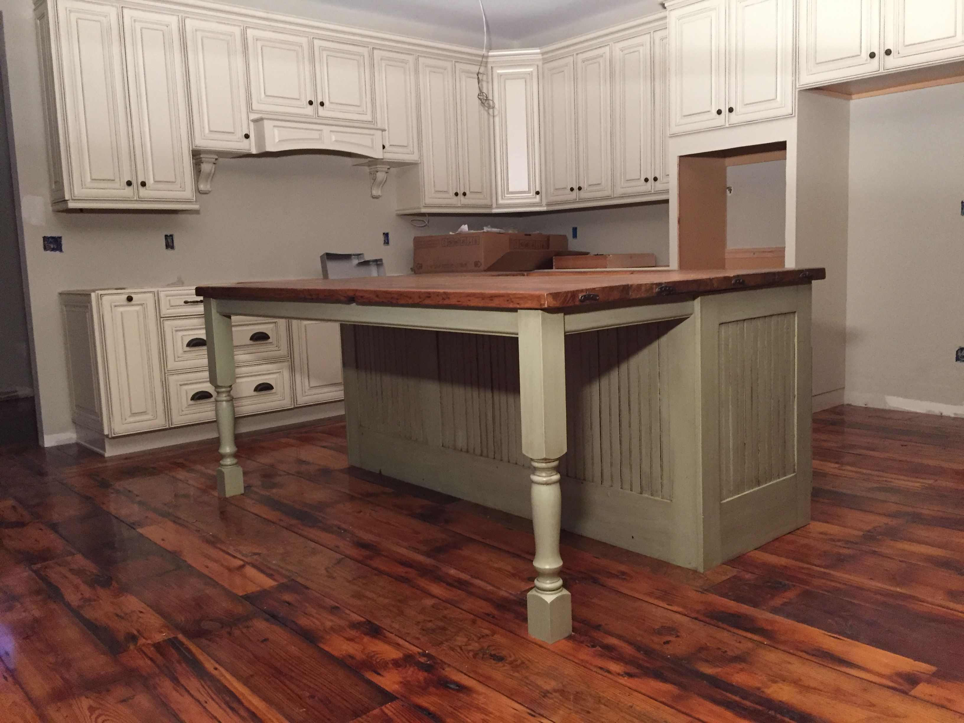 Reclaimed kitchen island with porch post legs All handmade all