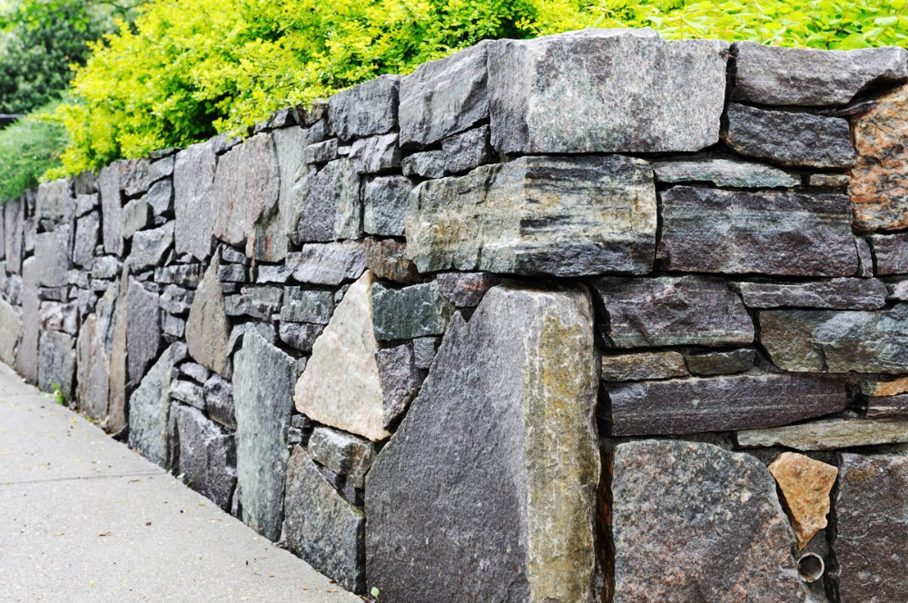 How Much Does A Retaining Wall Cost To Build In 2020 Building A Retaining Wall Stone Retaining Wall Retaining Wall Cost