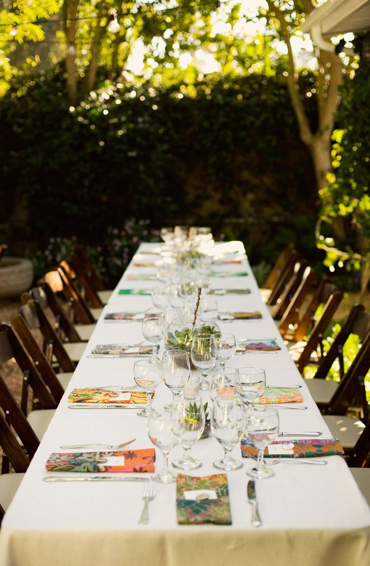 Great outdoor table setting that almost blends in with the venue.