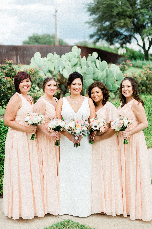 Photo of mismatched peach bridesmaid dresses