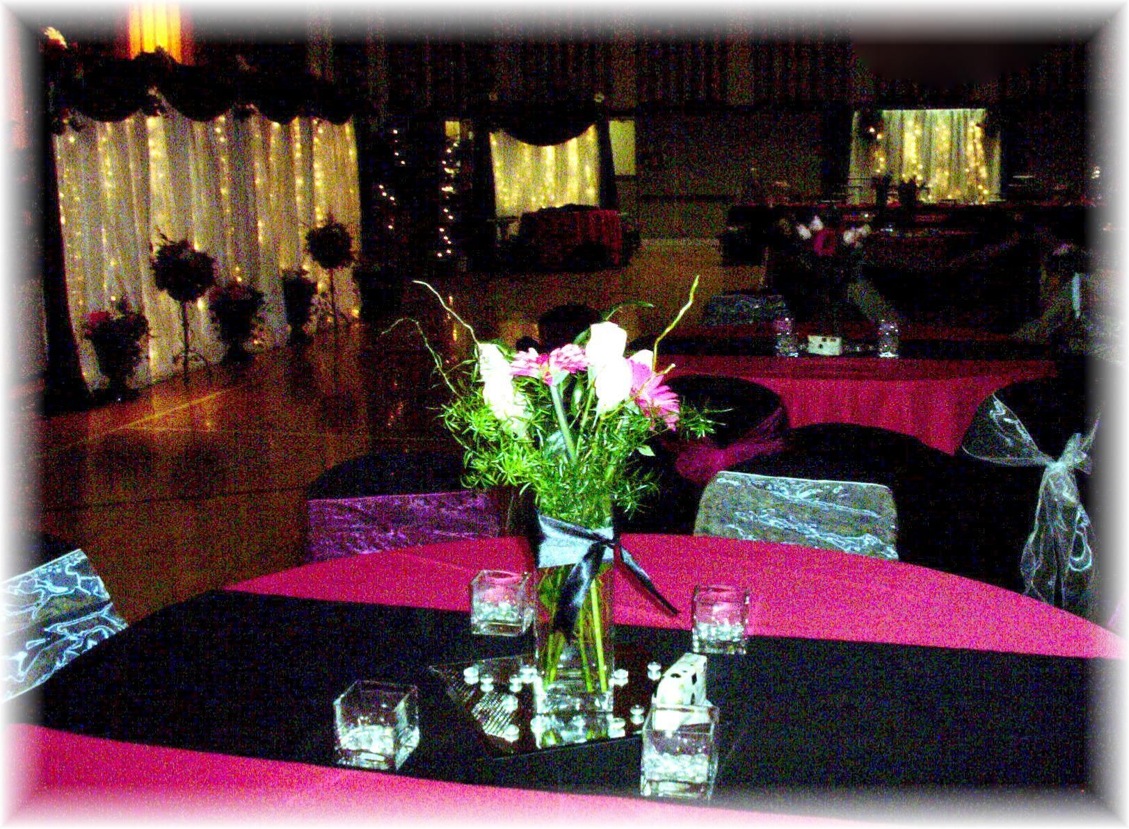 Hot pink black and white table centerpieces picture