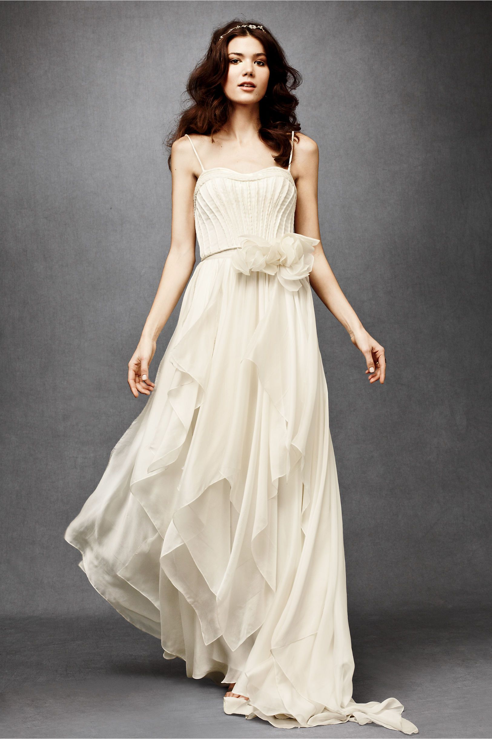 simple cheap wedding dresses Catherine Deane cascading goddess gown with asymmetrical wisps of fluid chiffon beneath a structured bodice via BHLDN Wedding Dresses