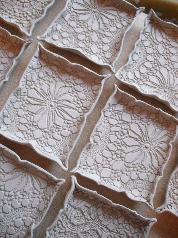 Use doilies to add texture to clay pottery in painting for Clay mural making