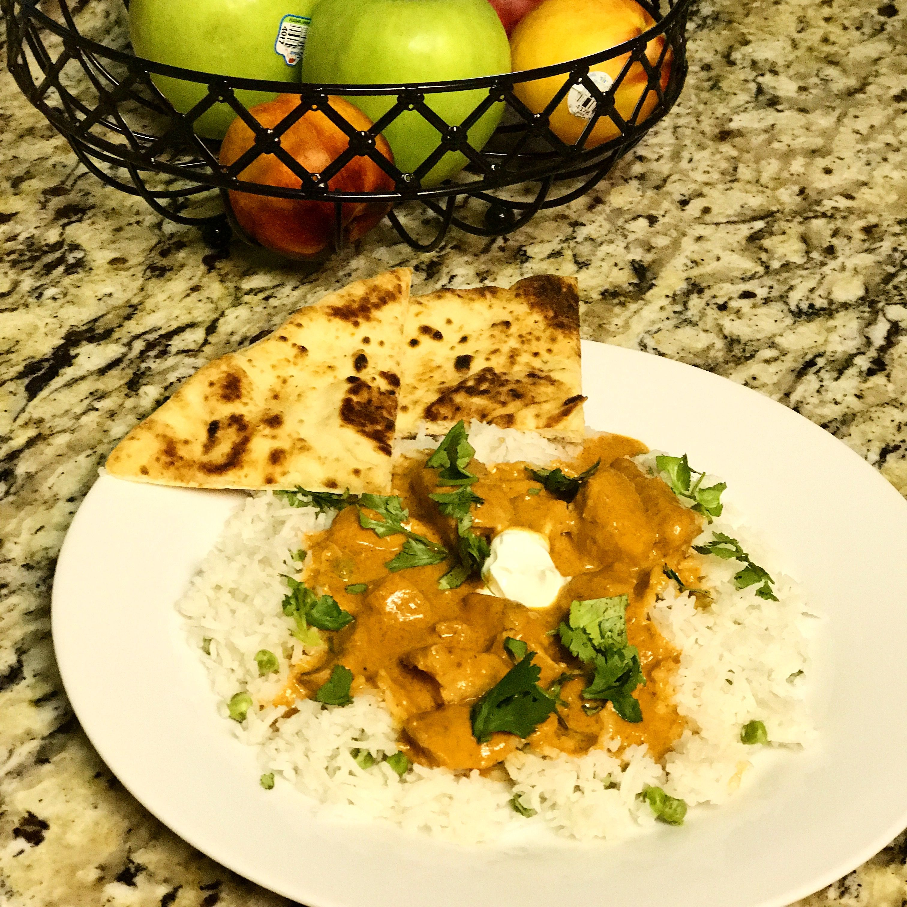 Butter chicken with cilantro basmati, and garlic naan, from scratch! Delilah!