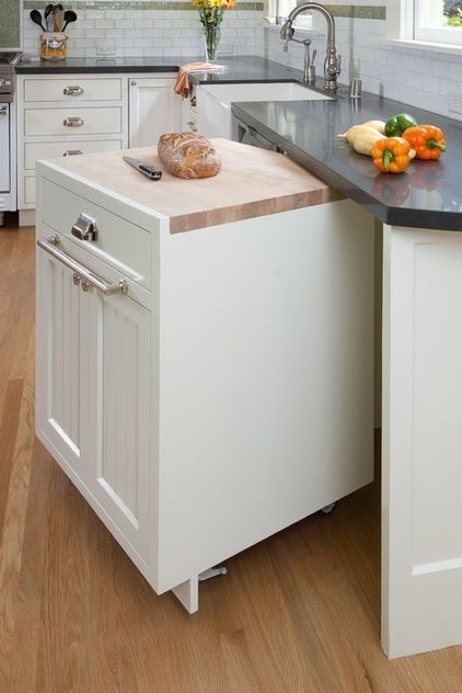 It sounds so simple, but so few of us think of it: make one base cabinet a rolling element, with a built-in chopping-block top for at-your-service accessibility. This is a great idea for small kitchens and large alike. If you don't like the look of casters, have your cabinetmaker conceal the wheels with a plinth for a completely inconspicuous solution. by diann