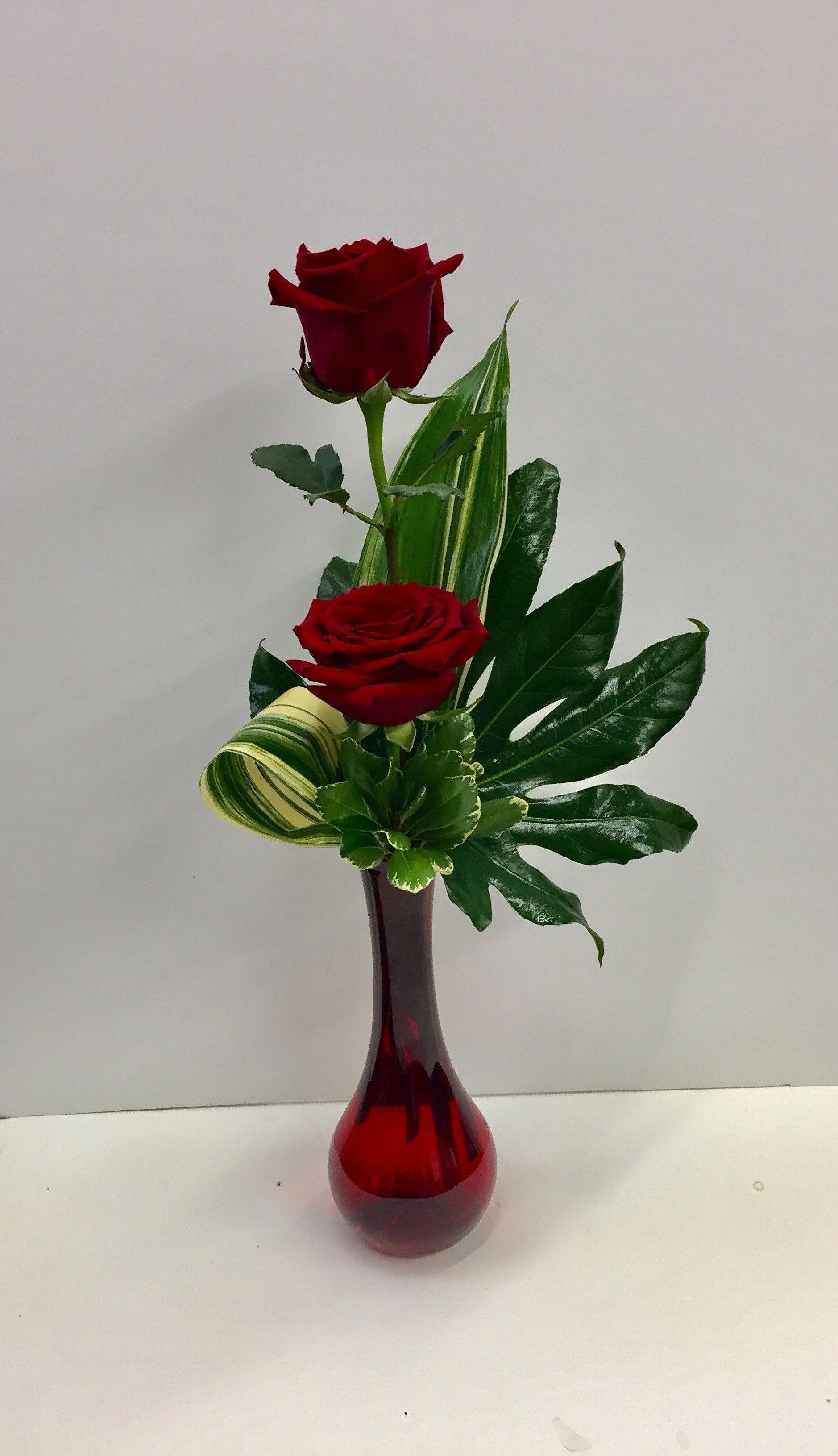 Image result for flower arrangement with a single rose