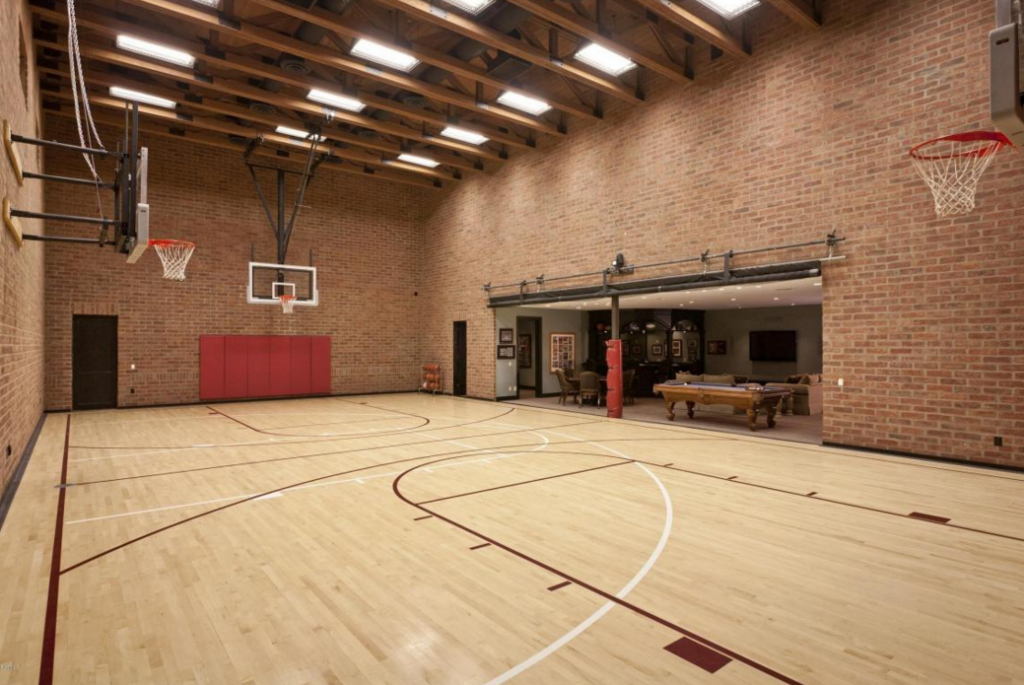 Indoor basketball court dream house pinterest indoor for Basketball court inside house