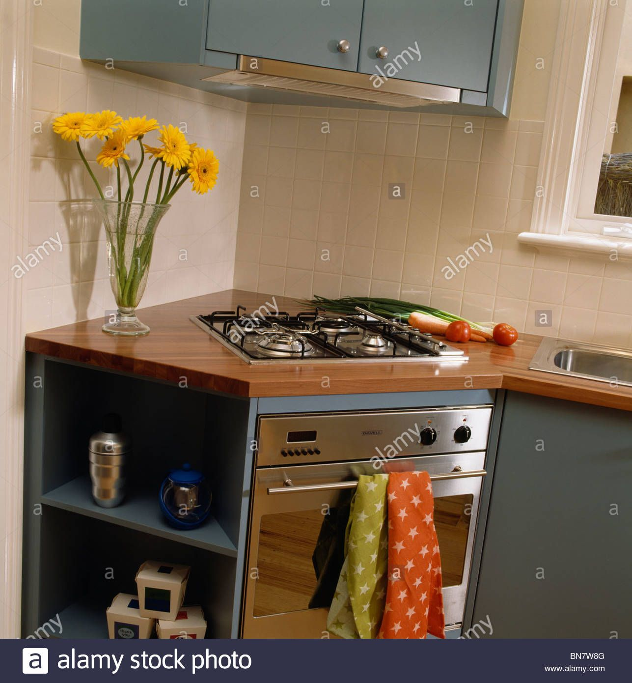 Hob And Oven In Fitted Corner Unit In Modern Kitchen Stock