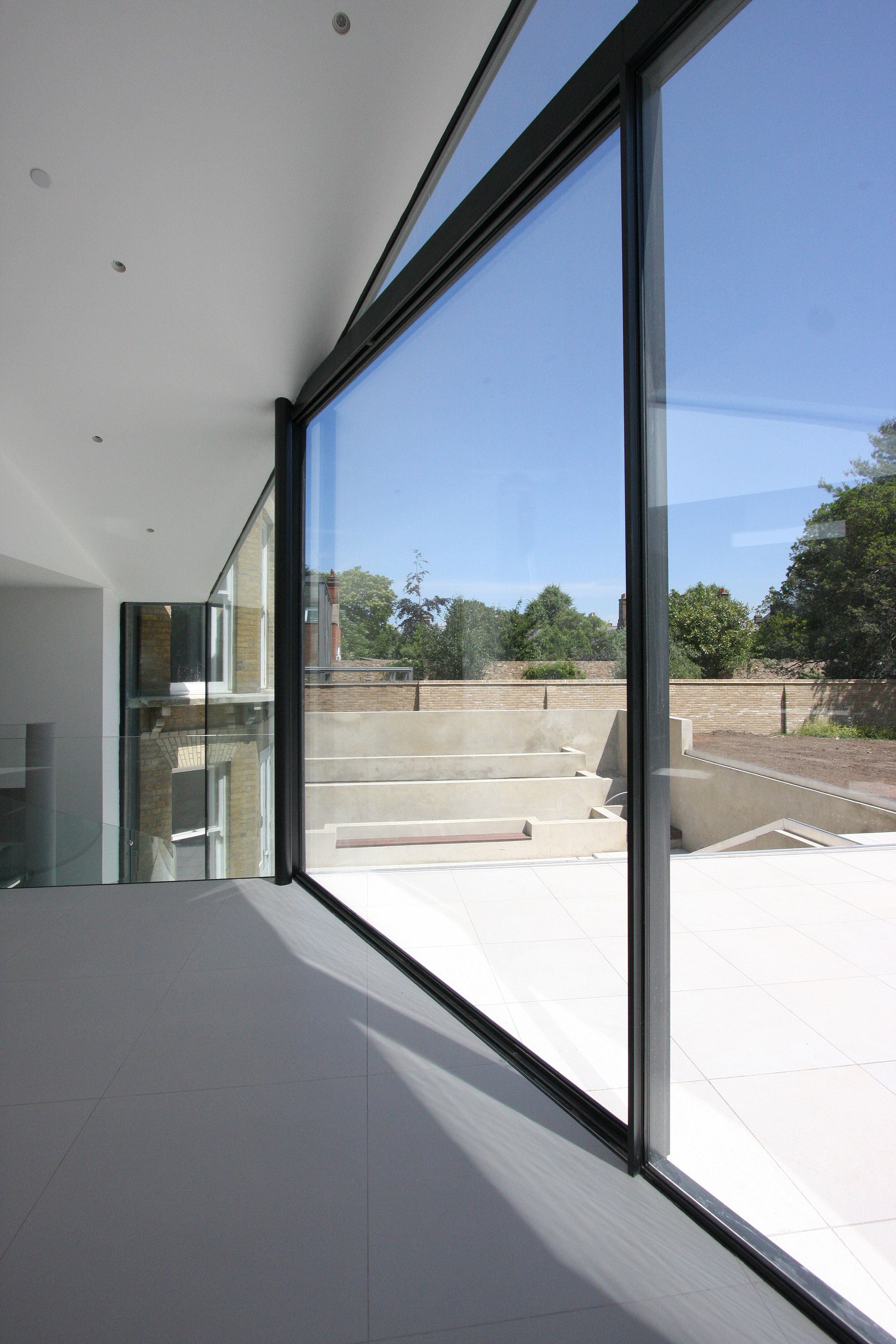 Large Glass Elevation, Sliding Minimal Windows Bringing The Outside In