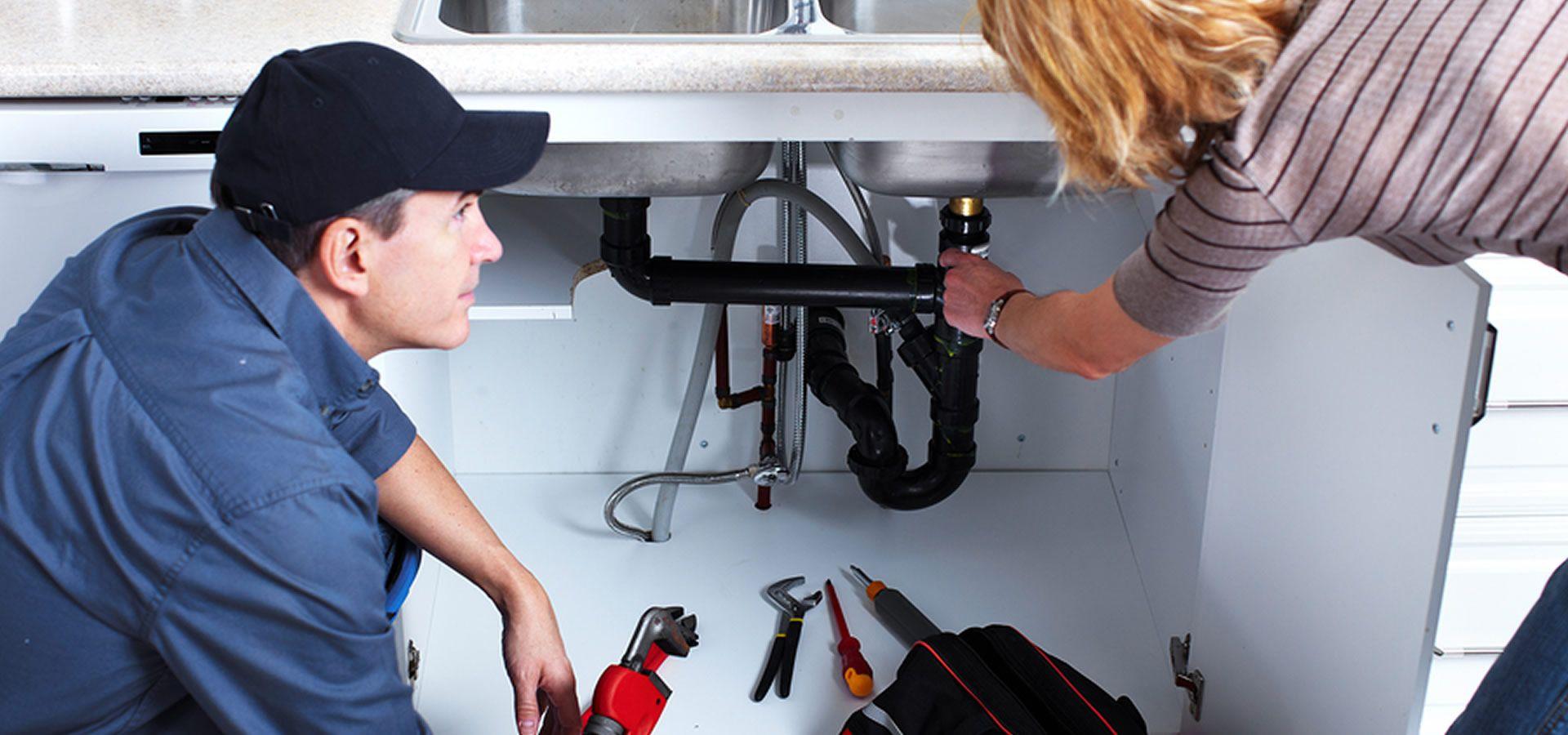 A plumber helping a homeowner Champion Plumbing & Drain