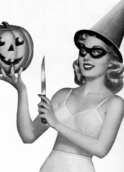 vintage pinup witch and pumpkin