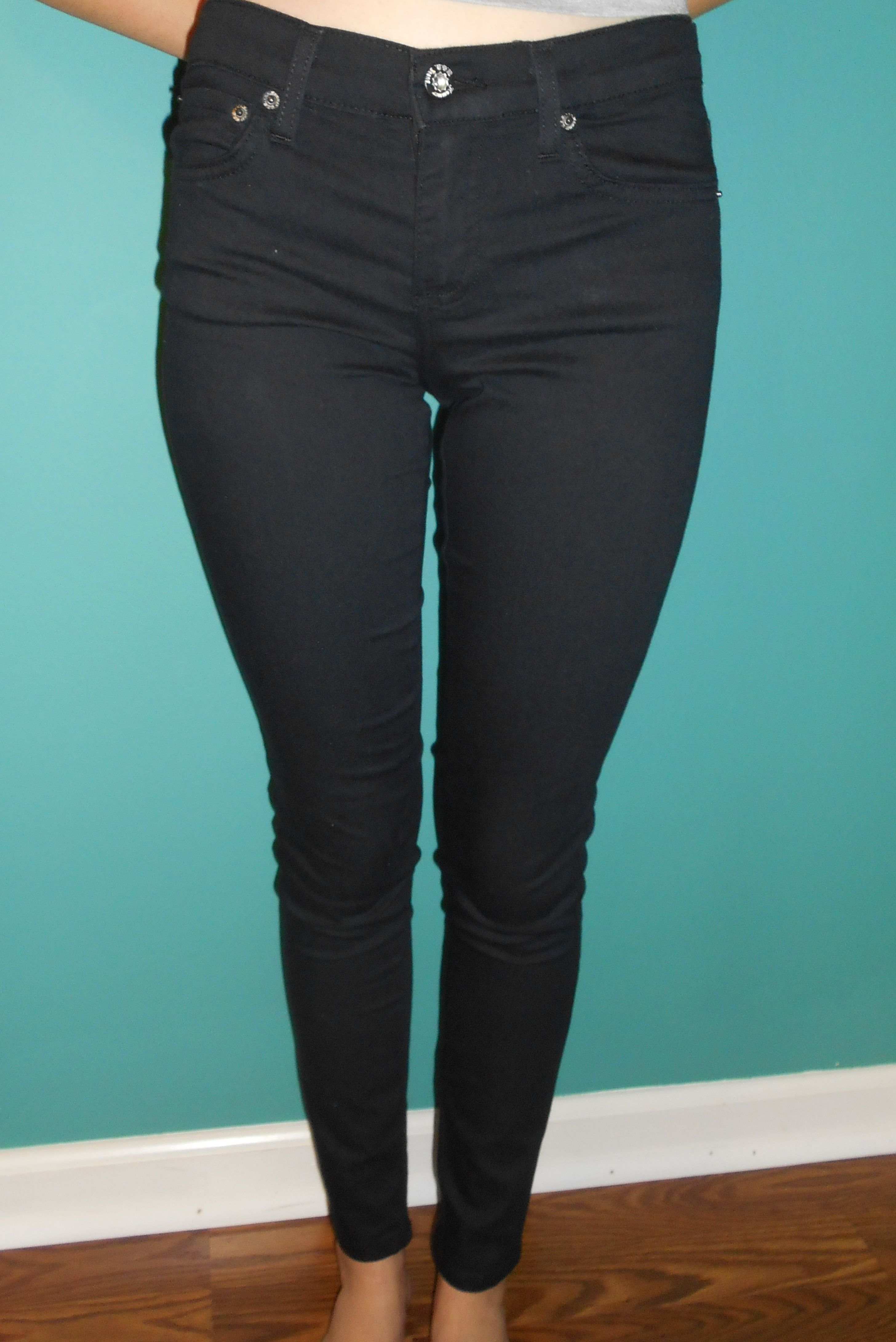 Black Skinny Jeans by Hammer USA. These are very comfortable jeans- fit a lot like jeggings, but do have actual pockets.  Model is 5'5, and wearing a 3.  Size 3: Waist (inches): 14 Inseam (inches): 29  Size 5: Waist (inches): 14.75 Inseam (inches): 29.5  Size 7 Waist (inches): 15 In...