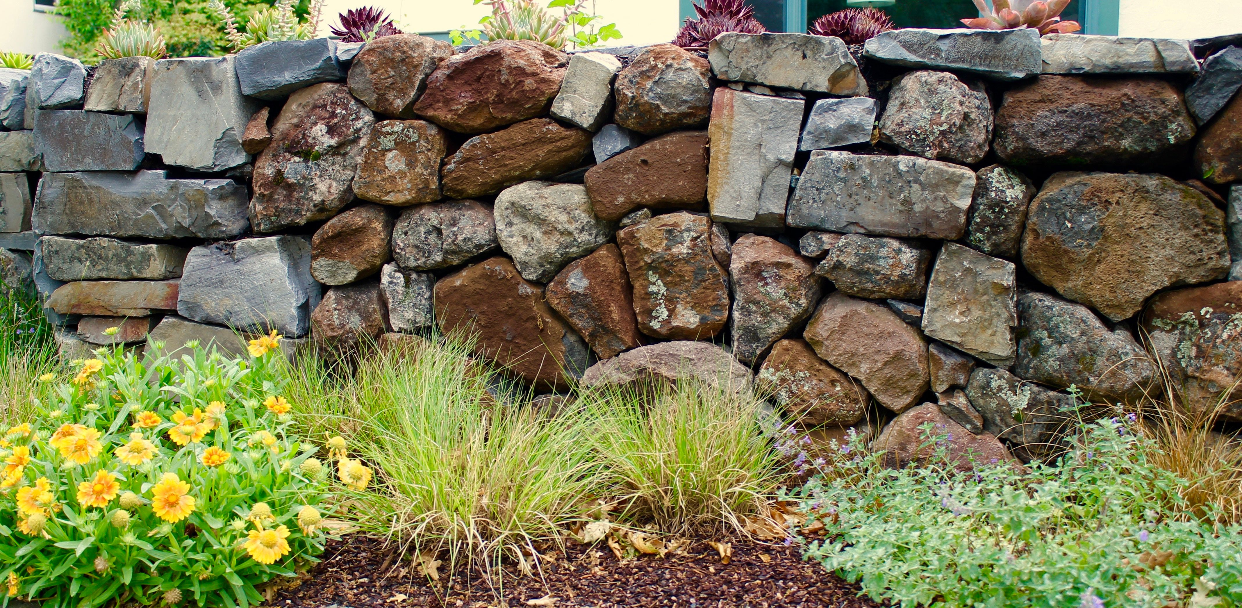 A Dry Laid Stone Wall Constructed Without Mortar Provides