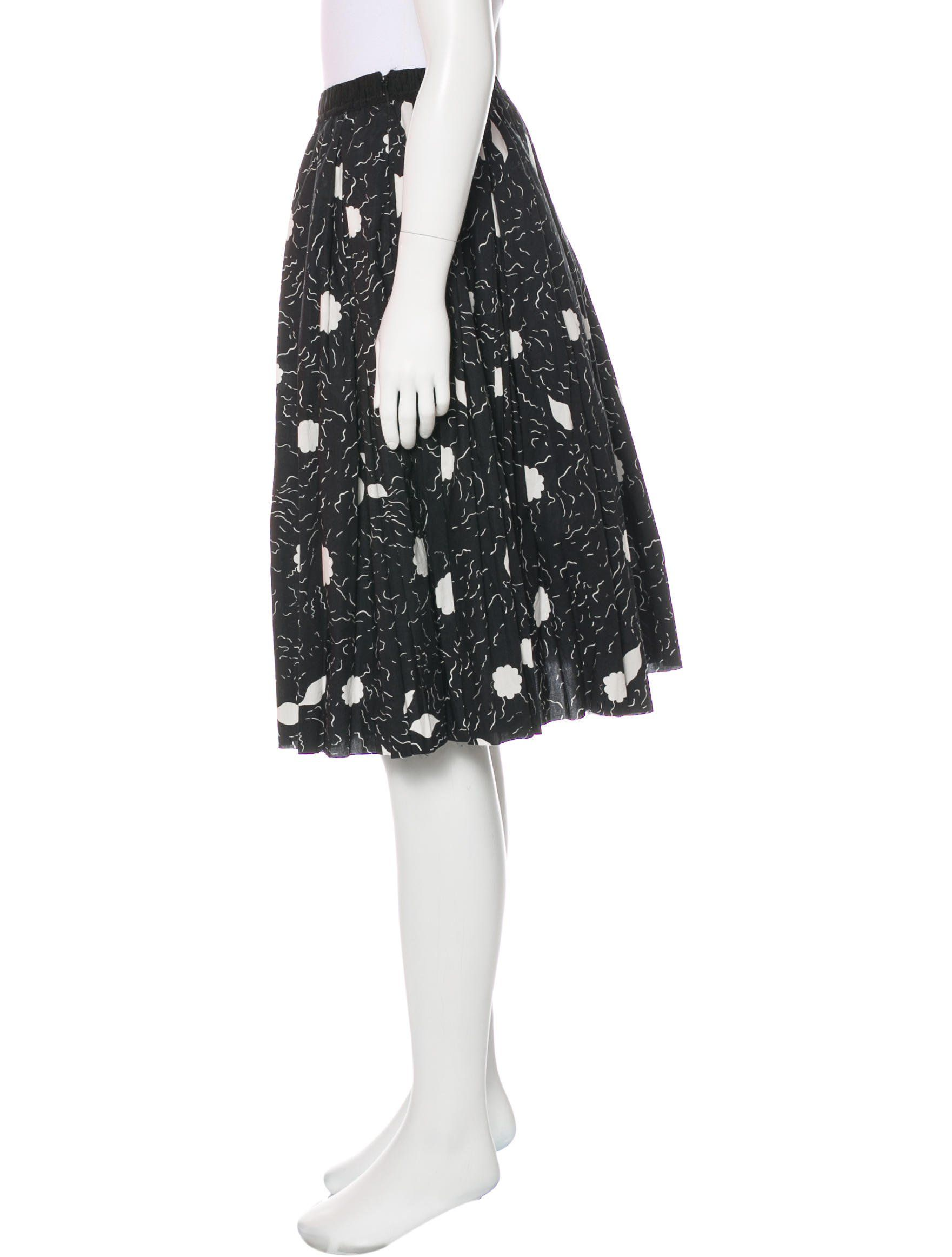 1682bc7b0 Black and white Marni knee-length skirt with abstract print throughout,  elasticized waistband, pleats, raw-edge hem and concealed zip closure at  side.