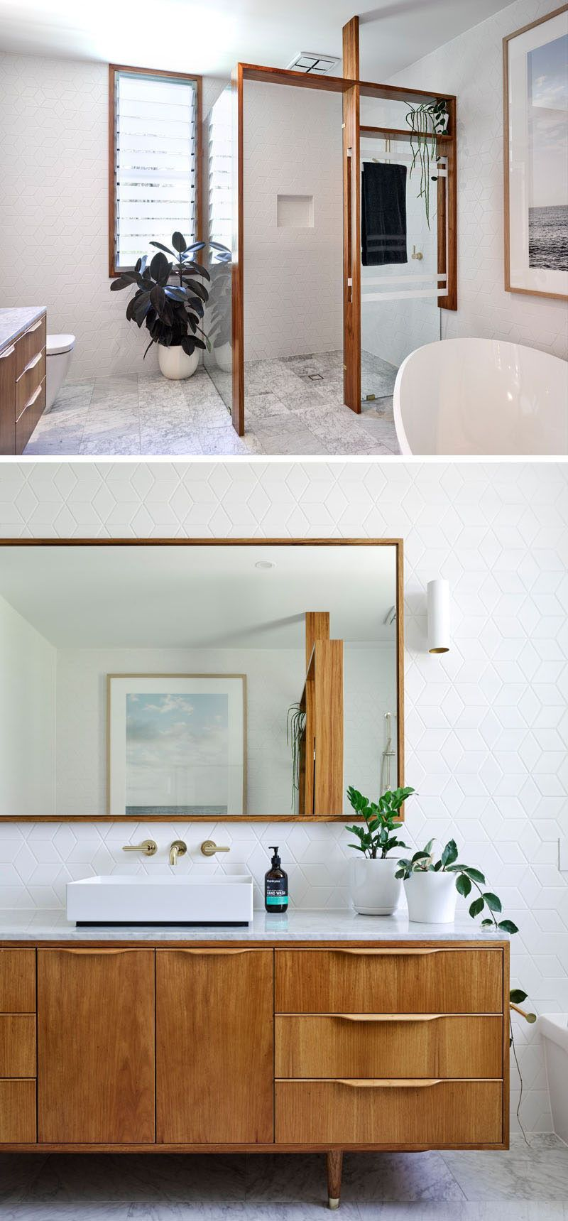 In this modern bathroom wood frames have been used to provide ...