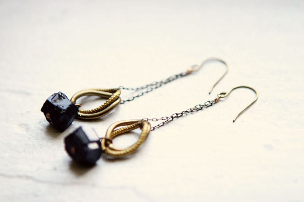 "Black tourmaline earrings with vintage brass links. Earrings measure 2-1/2 inches in length. Black tourmaline is a crystal boron silicate mineral. It was originally found in tin mines in Zschorlau, Germany. The name is derived from  the Sinhalese word turamali, meaning ""stone attracting ash."" Please note that due to the nature of vintage materials, slight variations in tone and color may occur.Due to the aberrant nature of minerals, each piece of gem/mineral is unique...."