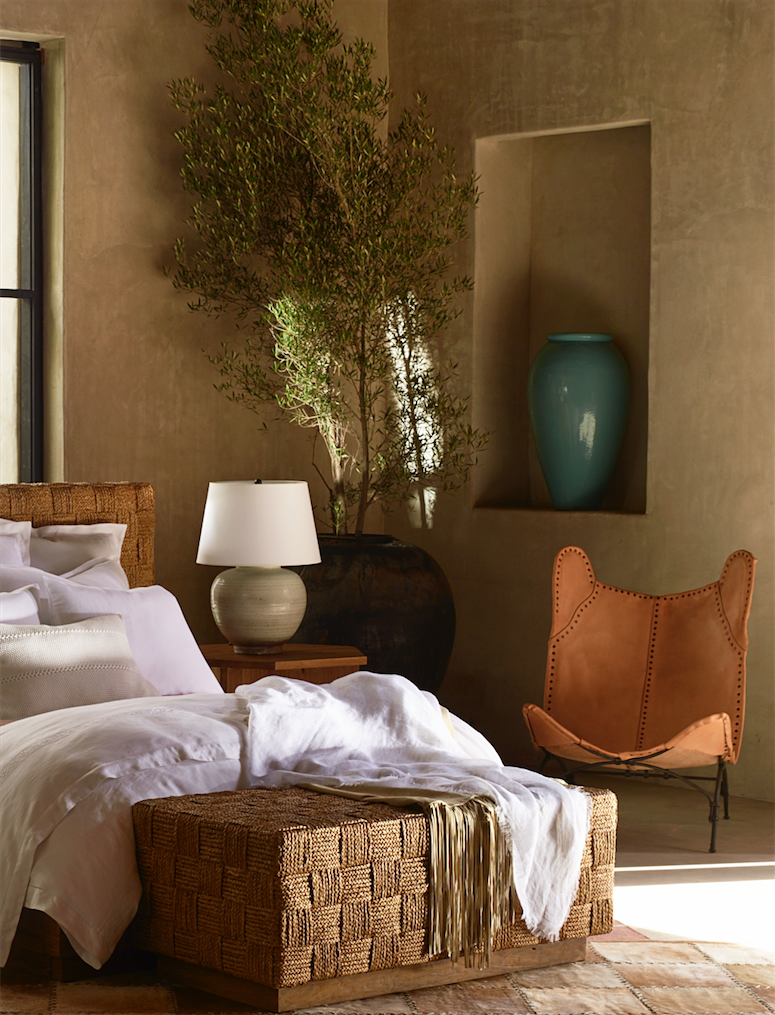 Give Your Bedroom A Serene Southwestern Feel With A Leather Butterfly Chair Woven Textures And