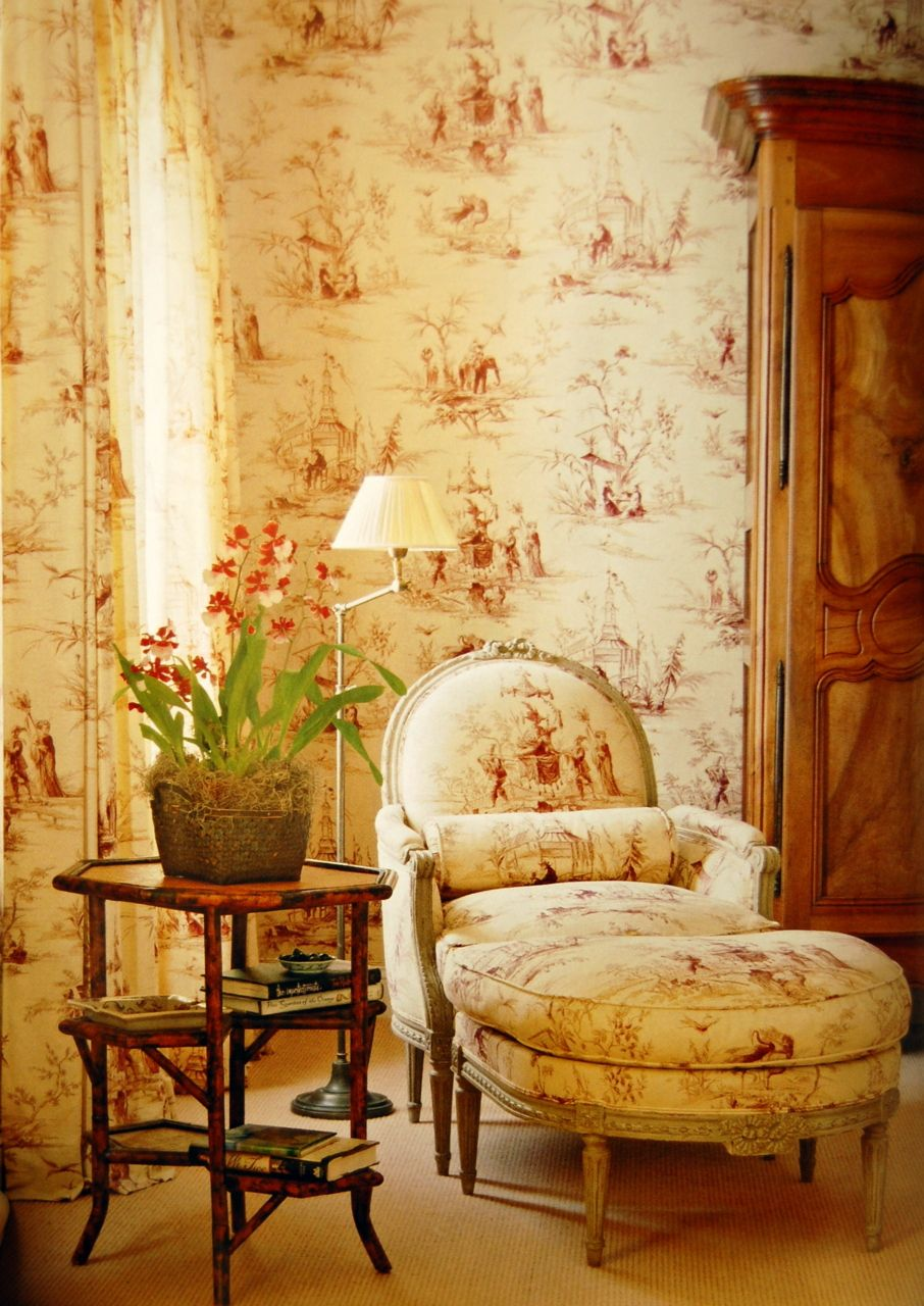 Good use of the toile, a nice chair & armoire & the burnt bamboo ...