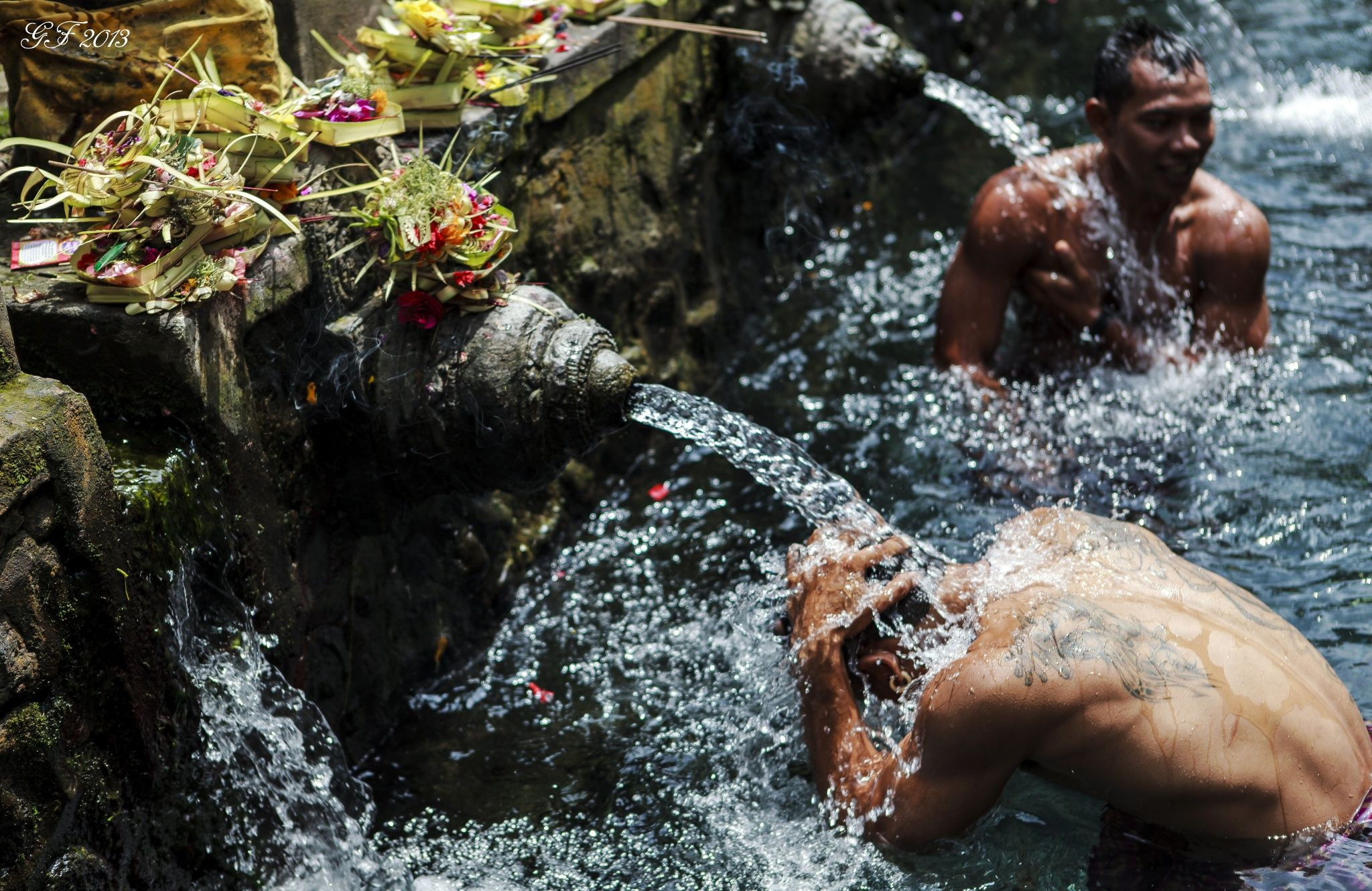 Purification by Gustavo Fernández on 500px - Tirta Empul Temple (Indonesian: Pura Tirta Empul) is a Hindu temple in the middle of Bali, famous for its holy water where Hindu people go for purification.