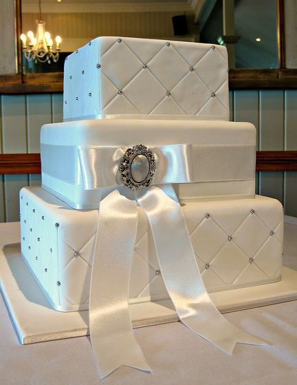 Three Tier Rectangular Quilted White Wedding Cake With Silver
