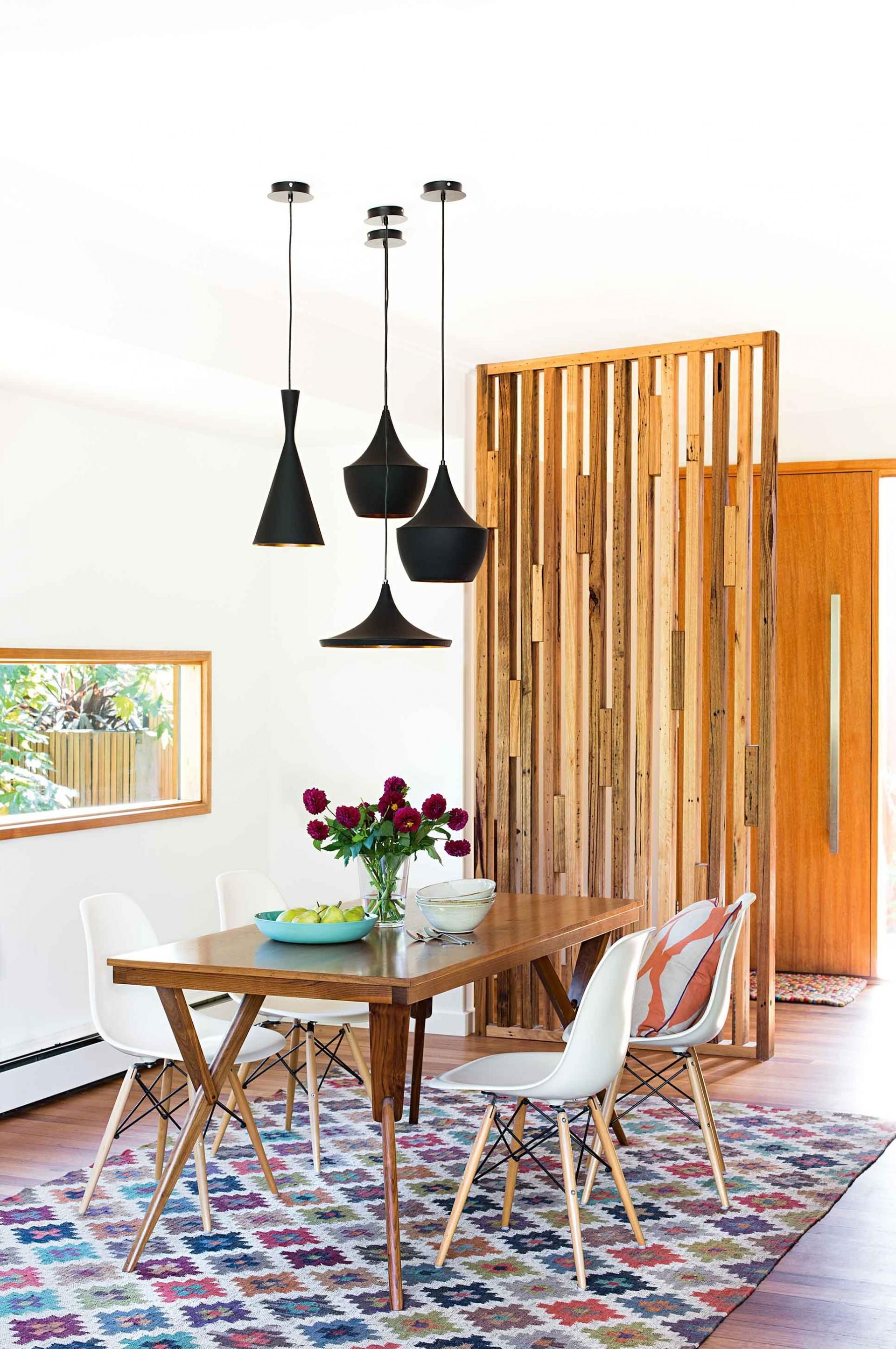 Unexpected lighting adds interest to the dining room.