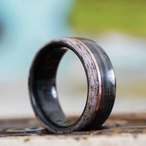 Photo of Weathered Whiskey Barrel Wood Wedding Ring with Elk Antler Edge and Offset Gold Inlay