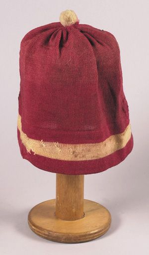 Scarce skull style football stocking cap c. 1890 s. Knit wool red cap with  white stripe and ball on top. Cap has appropriate usage wear with some  period ... 71e4a4c0316