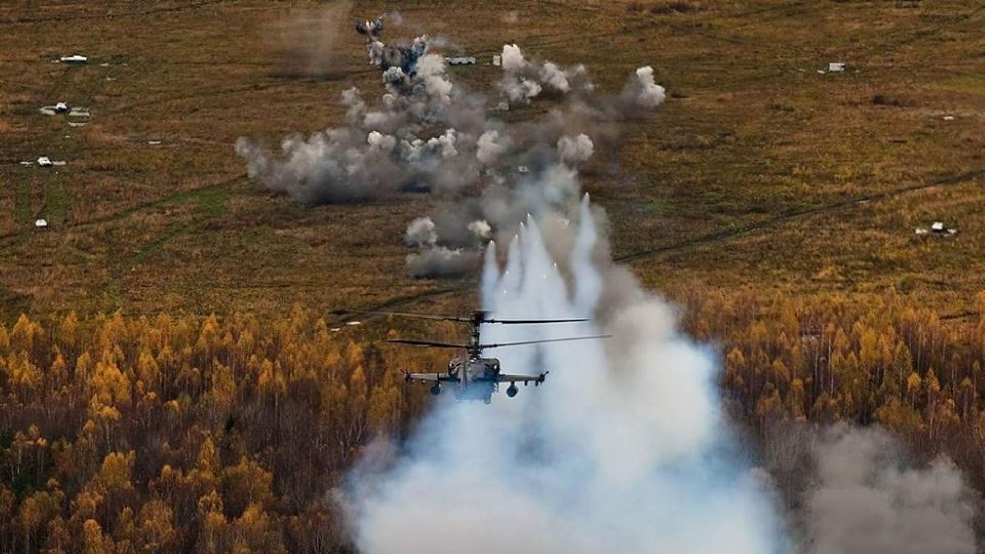 RFAF Ka-52 'alligator' firing rockets...
