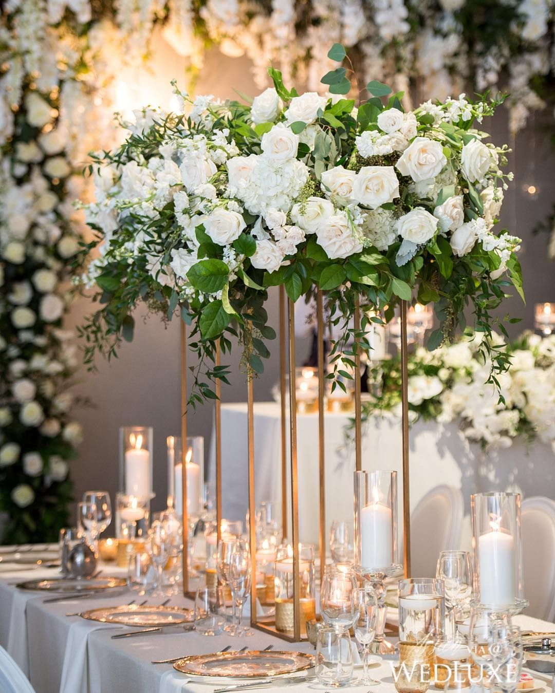 White florals, metallic gold accents, and flickering candles make up this breathtaking #tablescape | Photography By: Amsis Photography | WedLuxe Magazine | #WedLuxe #Wedding #luxury #weddinginspiration #luxurywedding #tabledecor #floral
