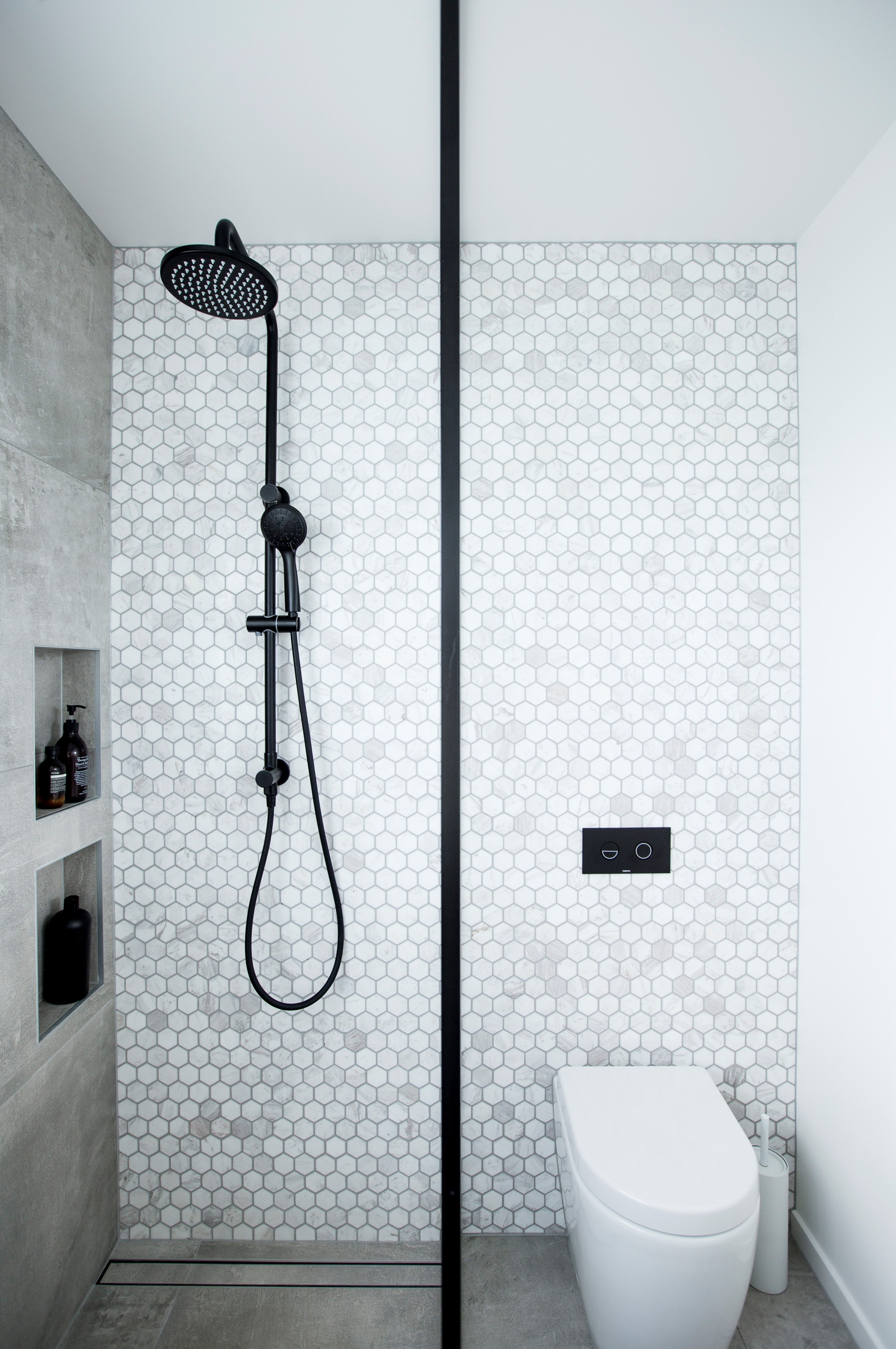 Marble Hexagon feature wall with concrete look floor to ceiling