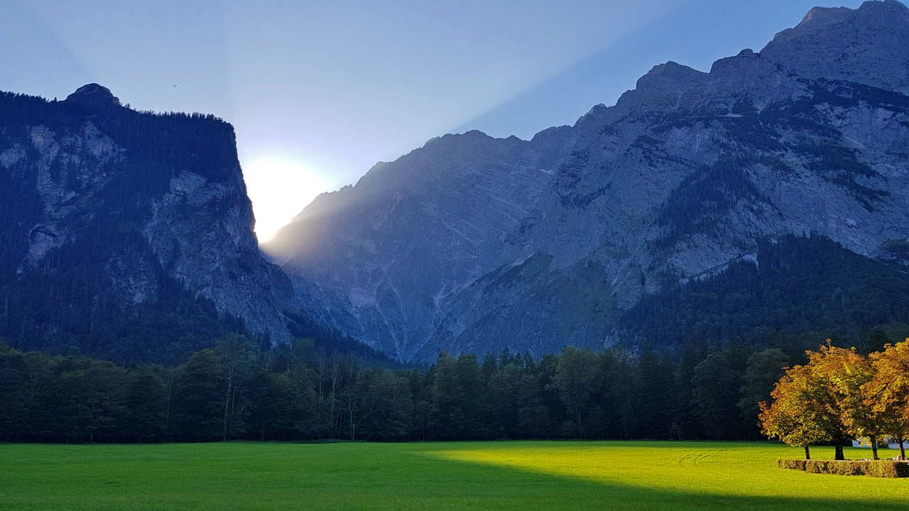 Beautiful Landscape Of Rocky Mountains And Green Meadow In Sunlight Sunlight Beautiful Landscape Beauty In Nature Day Environment Grass Green Color Green Meadow