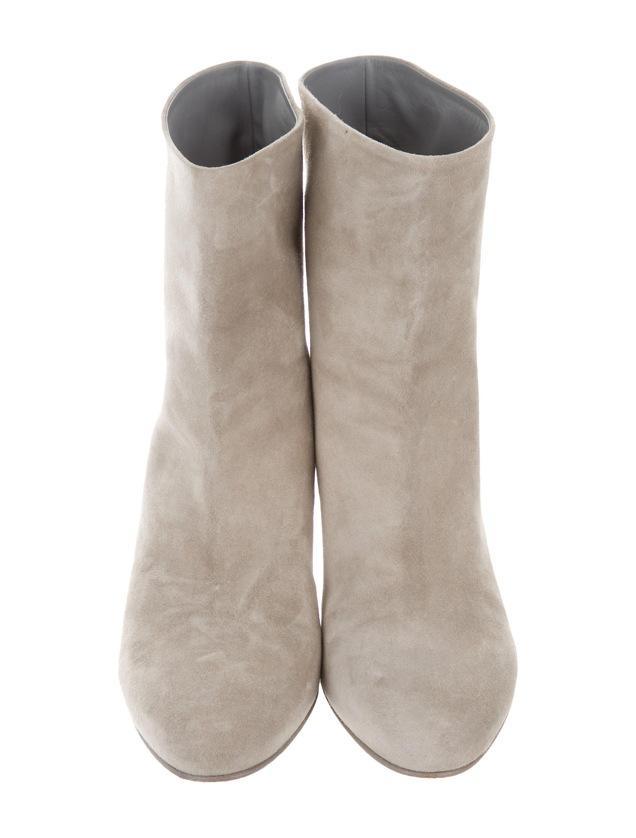6c303298f0 Creme suede Chanel ankle boots with round toes, gold-tone interlocking CC  accents at uppers and stacked block heels.