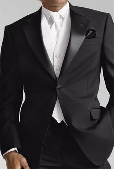 Groom in gorgeous black suit, white vest and white tie ...